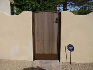 Composite wood and wrought iron backyard entry gate.