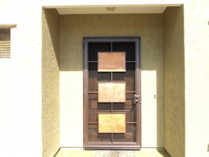 Mid-century modern-style security door secures a home.
