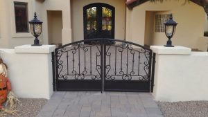 Ornate wrought iron gate for a home's courtyard.