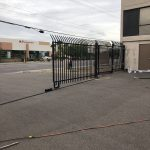A wrought iron commercial security gate protects a business while providing access control.