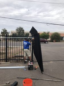 The DCS Industries team installs a wrought iron commercial security gate.