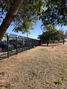 Wrought iron commercial security fencing protects a business.