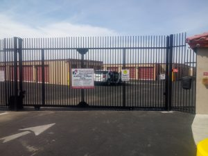Wrought iron rolling security gate secures a self-storage facility